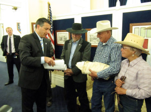 Nevada Gov. Brian Sandoval (from left) accepts petitions from Assemblyman Ira Hansen and Battle Mountain ranchers Peter and Lynn Tomera in May 2014. The Tomeras have received funds from a federal drought disaster relief program. Credit: Sandra Chereb/Associated Press